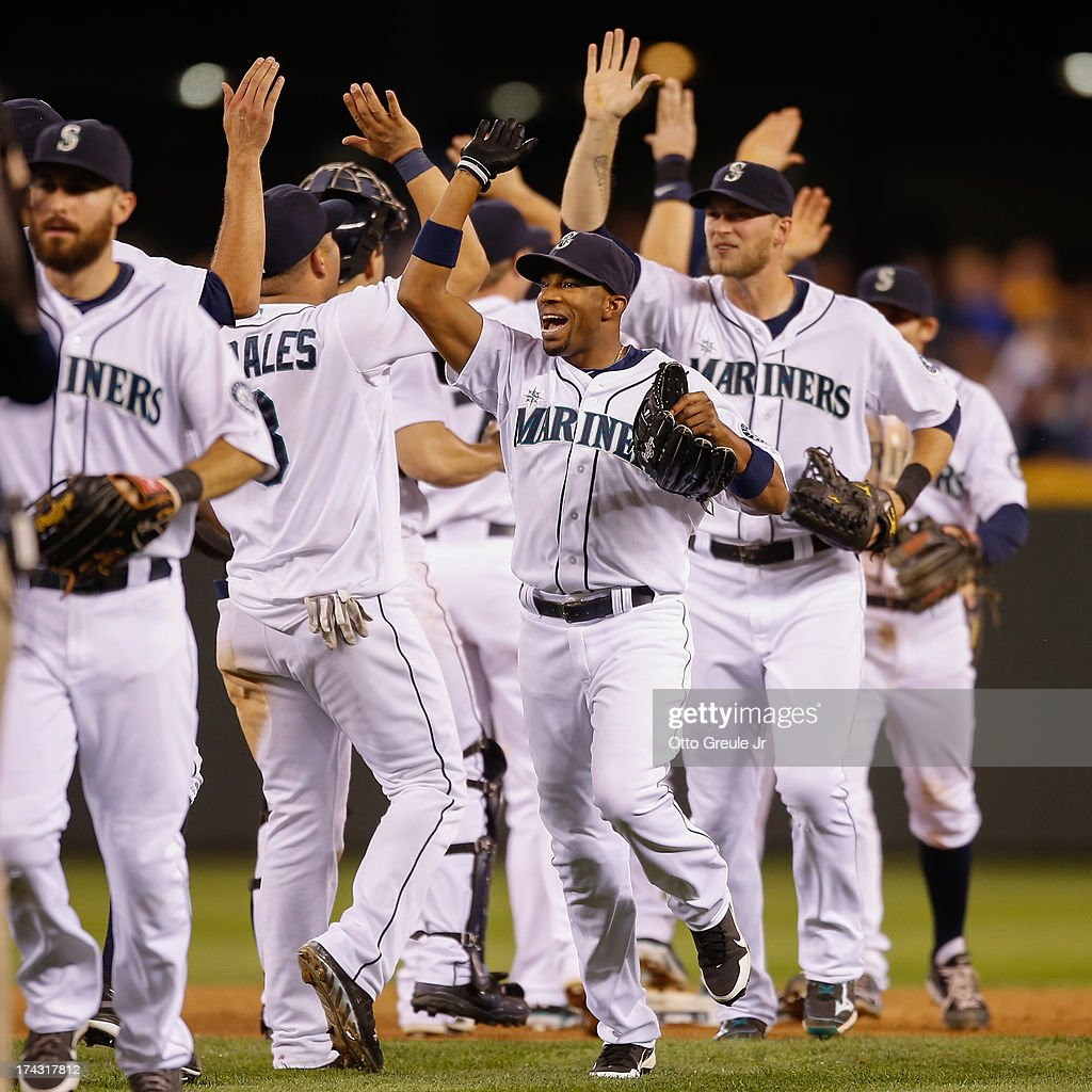 Members of the Seattle Mariners celebrate after defeating the Cleveland Indians 4-3 at Safeco Field on July 23, 2013 in Seattle, Washington.