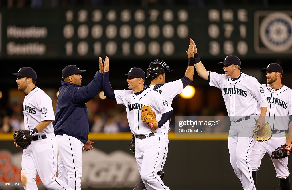 Members of the Seattle Mariners celebrate after defeating the Houston Astros 3-0 on Opening Day at Safeco Field on April 8, 2013 in Seattle, Washington.