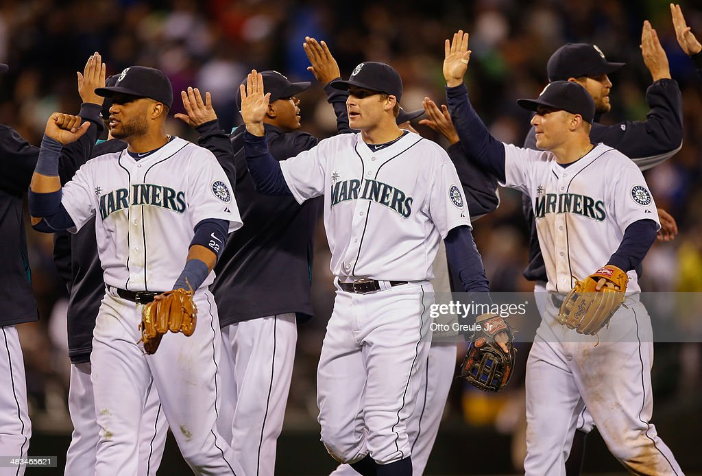 Members of the Seattle Mariners celebrate after defeating the Los Angeles Angels of Anaheim 5-3 on Opening Day at Safeco Field on April 8, 2014 in Seattle, Washington.