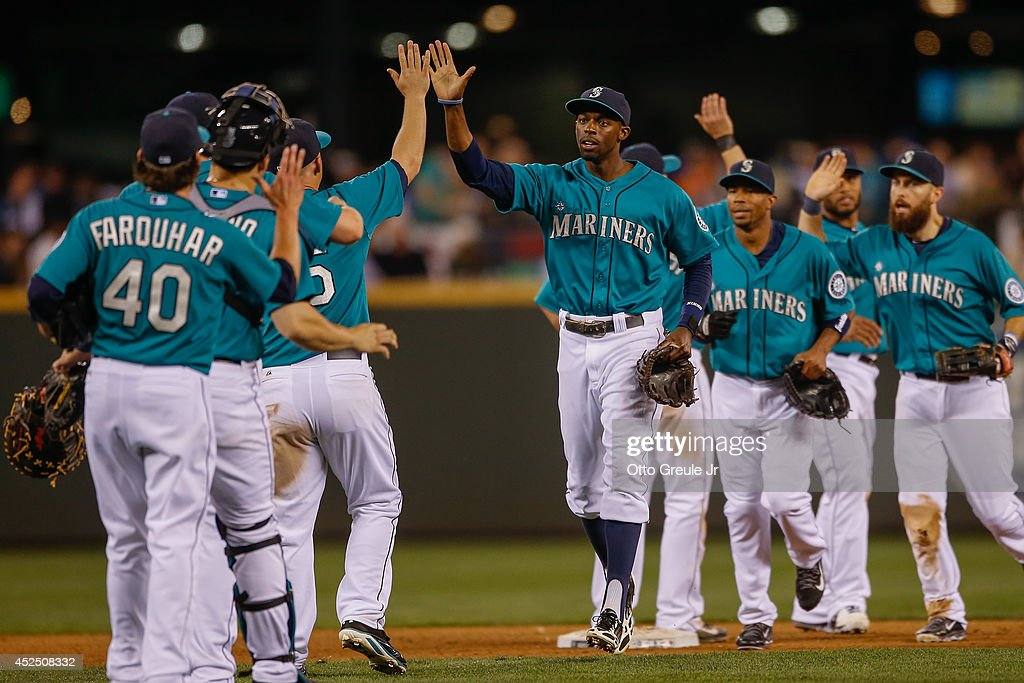 Members of the Seattle Mariners celebrate after defeating the New York Mets 5-2 at Safeco Field on July 21, 2014 in Seattle, Washington.