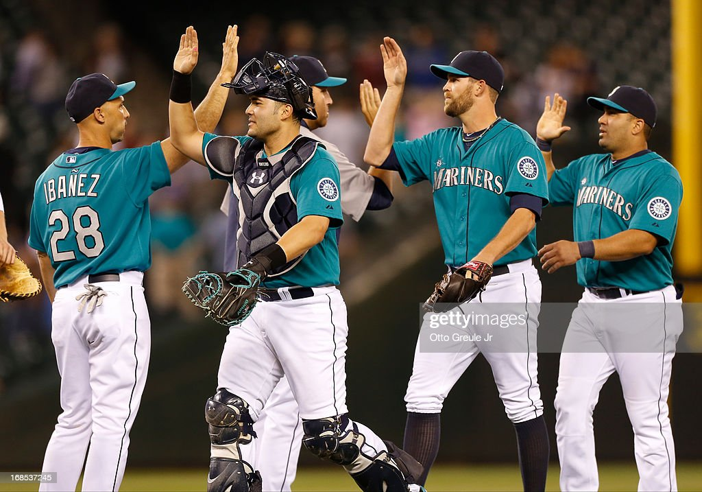 Members of the Seattle Mariners celebrate after defeating the Oakland Athletics 6-3 at Safeco Field on May 10, 2013 in Seattle, Washington.