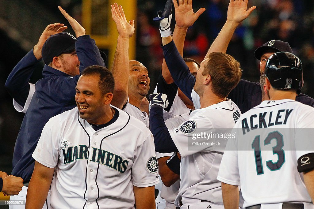 Members of the Seattle Mariners celebrate after defeating the Texas Rangers 4-3 at Safeco Field on May 26, 2013 in Seattle, Washington.