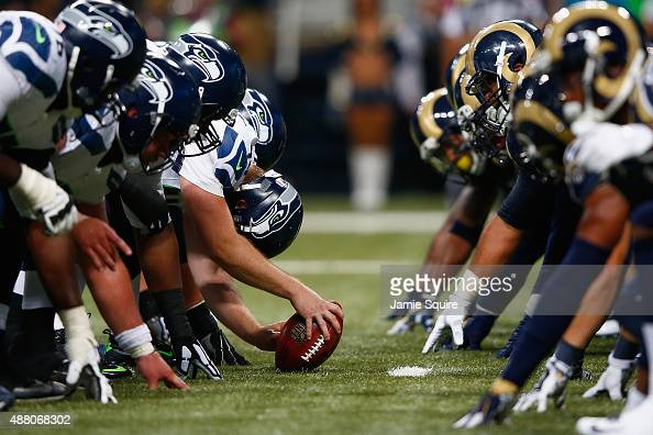 Members of the Seattle Seahawks and St Louis Rams at the line of scrimmage in the first half at the Edward Jones Dome on September 13 2015 in St...
