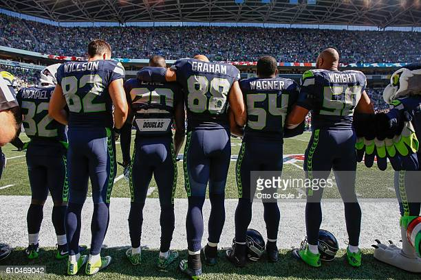 Members of the Seattle Seahawks lock arms during the national anthem prior to the game against the San Francisco 49ers at CenturyLink Field on...
