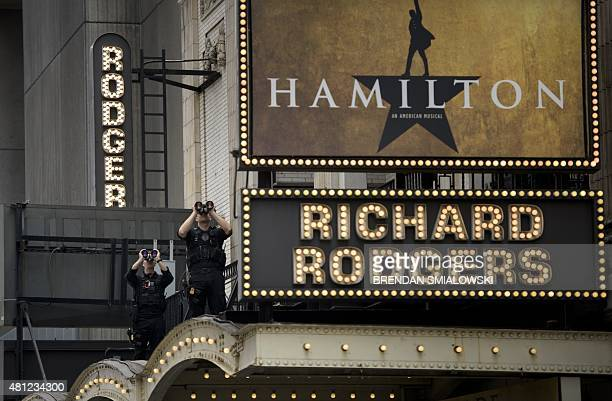 Members of the Secret Service counter sniper team watch over the Richard Rodgers Theatre while US President Barack Obama attends a showing of...