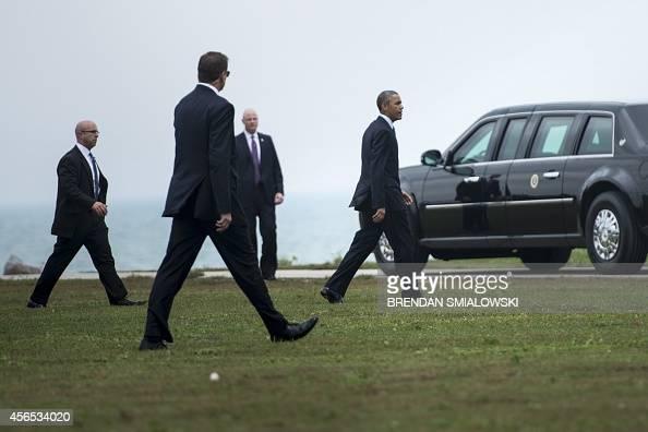 Members of the Secret Service follow as US President Barack Obama arrives at Northwestern University October 2 2014 in Evanston Illinois AFP...