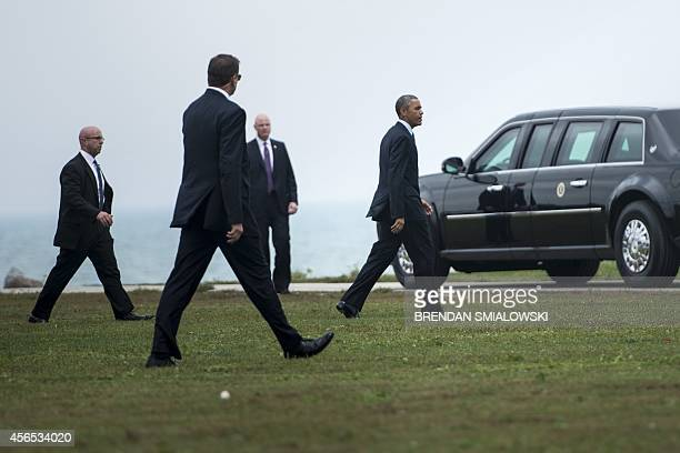 Members of the Secret Service follow as US President Barack Obama arrives at Northwestern University October 2 2014 in Evanston Illinois AFP...