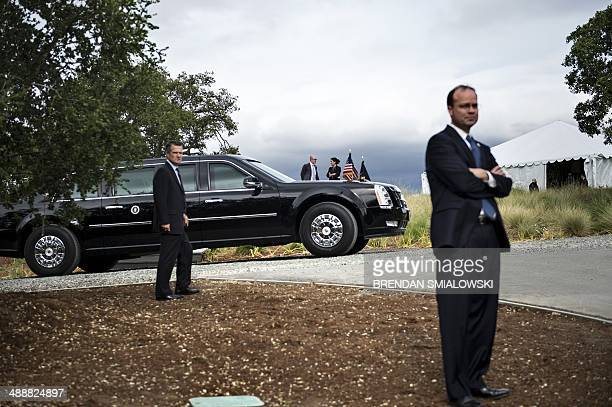 Members of the Secret Service watch while US President Barack Obama attends a Democratic National Committee roundtable at the home of Anne Wojcicki...