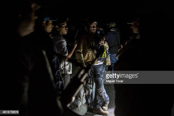 Members of the selfdefense group remain on alert in a checkpoint of Paracuaro in Michoacan Mexico Despite some success by selfdefense groups to free...