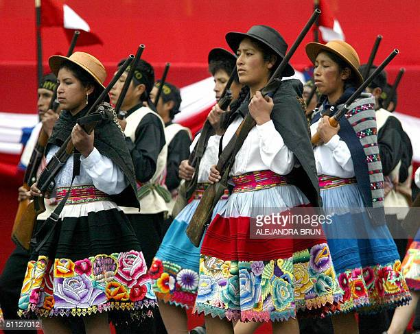 Members of the SelfDefense group take part in the official parade celebrating the 183rd Anniversary of the Peruvian Independence in Lima 29 July 2004...