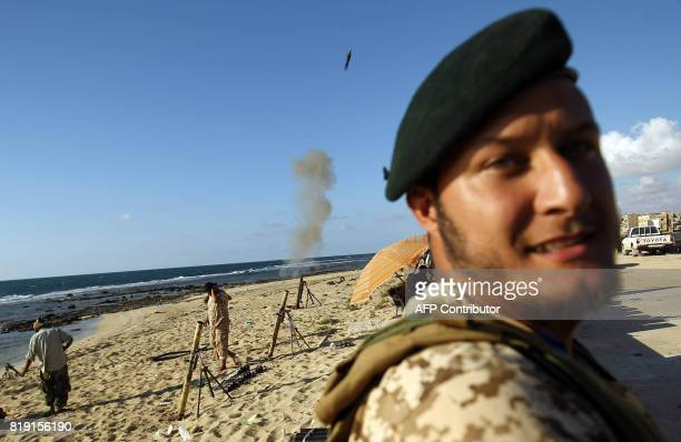 TOPSHOT Members of the selfstyled Libyan National Army loyal to the country's east strongman Khalifa Haftar fire mortars during clashes with...