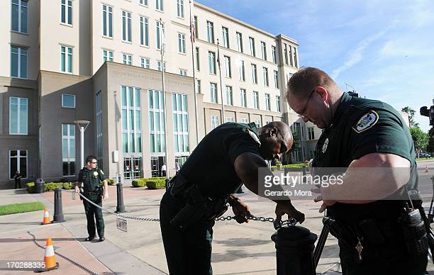 Members of the Seminole County Sheriff's Office guard the Seminole County Courthouse during the first day of trial for George Zimmerman on June 10...