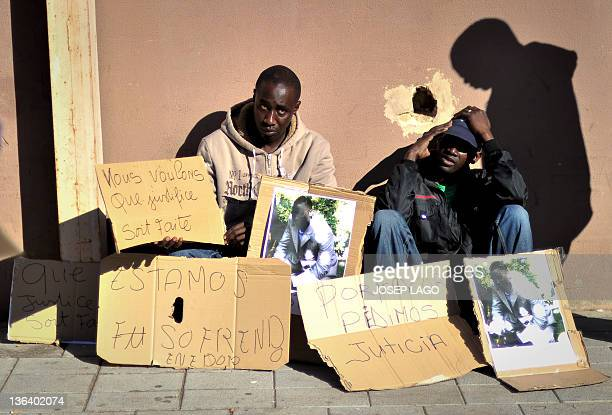 Members of the Senegalese community take part in a demonstration in Sant Adria del Besos in Barcelona on January 4 to protest against the death of a...
