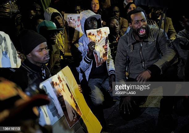 Members of the Senegalese community take part in a demonstration in Sant Adria del Besos near Barcelona on January 4 to protest against the death of...
