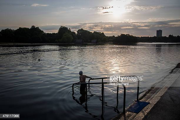 Members of the Serpentine Swimming Club enjoy an early morning swim in the Serpentine Lake in Hyde Park on July 1 2015 in London England The Met...