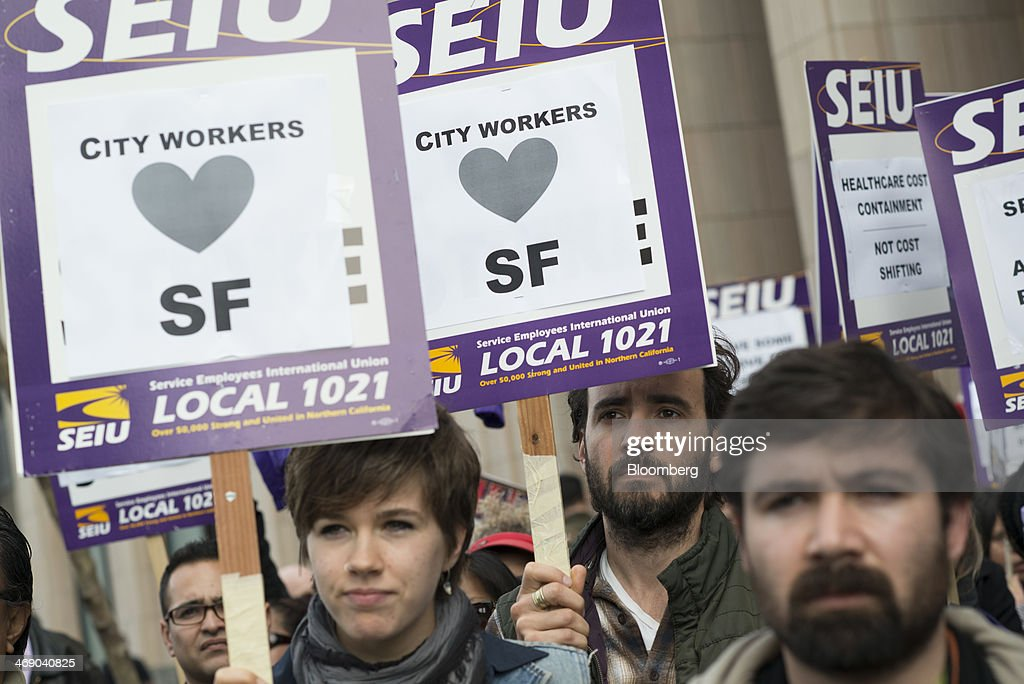 Members of the Service Employees International Union (SEIU) Local 1021 carry signs that read 'City Workers Love SF' while protesting in front of Twitter Inc. headquarters in San Francisco, California, U.S., on Wednesday, Feb. 12, 2014. City workers represented by SEIU 1021 are participating in an affordable healthcare rally. Photographer: David Paul Morris/Bloomberg via Getty Images