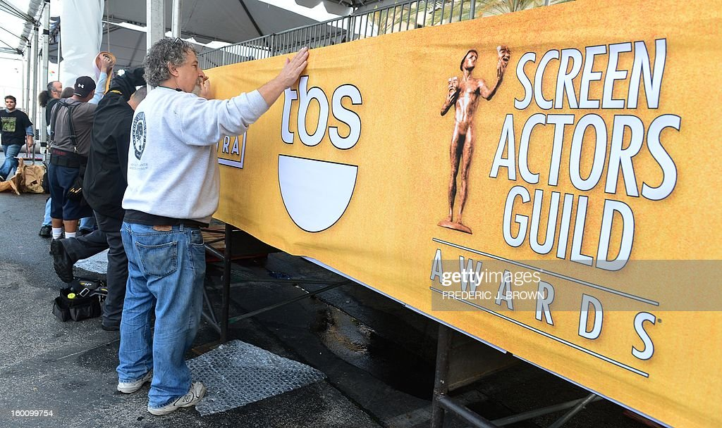 Members of the setup crew hang banners in Los Angeles on January 26, 2013 during preparations ahead of the 19th Annual Screen Actors Guild (SAG) Awards on January 27. AFP PHOTO/Frederic J. BROWN