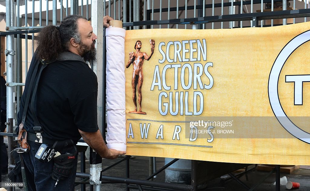 Members of the setup crew hang banners in Los Angeles on January 26, 2013 during behind the scenes preparations ahead of the 19th Annual Screen Actors Guild (SAG) Awards on January 27. AFP PHOTO/Frederic J. BROWN