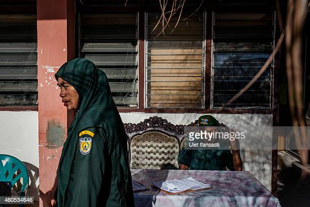 Members of the sharia police known as Wilayatul Hisbah is seen in their office as they prepare for patrol on December 12 2014 in Banda Aceh Indonesia...