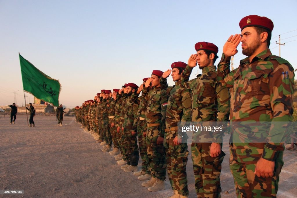 Members of the Shiite Muslim Mehdi Army militia take part in training in the southern Iraqi city of Basra on June 17 2014 Iraqi Shiite volunteers who...