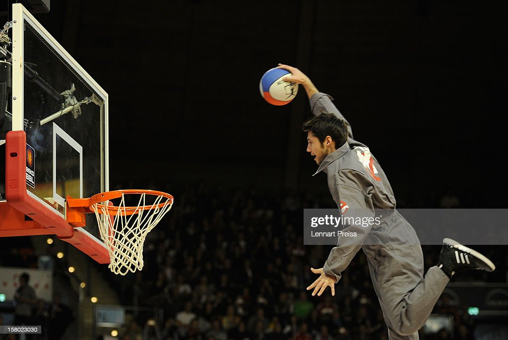 Members of the showteam Crazy Dunkers perform at halftime during the Beko Basketball match between FC Bayern Muenchen and Telekom Baskets Bonn at Audi-Dome on December 9, 2012 in Munich, Germany.