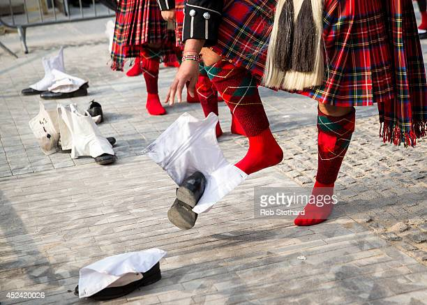 Members of the Shree Muktajeeven Swamibapa pipe band remove their shoes before entering the temple during Guru Purnima an Indian festival dedicated...