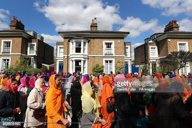 Members of the Sikh community take part in the Nagar Kirtan procession through Gravesend in Kent during the Sikh festival of Vaisakhi