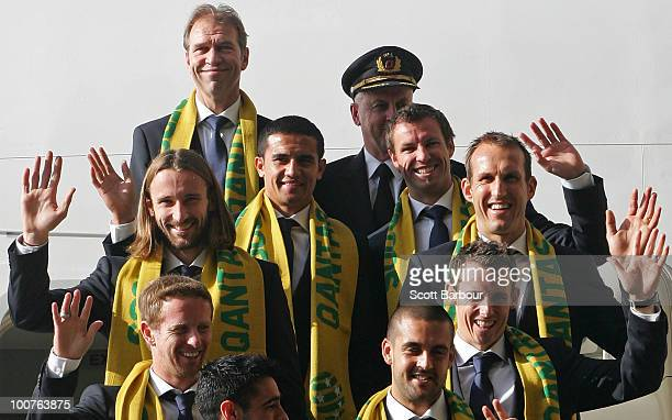 Members of the Socceroos including coach Pim Verbeek and captain Lucas Neill wave as they board their aeroplane during the Australian Socceroos...
