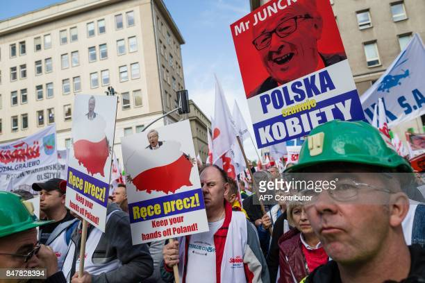 Members of the Solidarity trade union protest against EU objections to a new law by the country's rightwing government lowering the retirement age in...