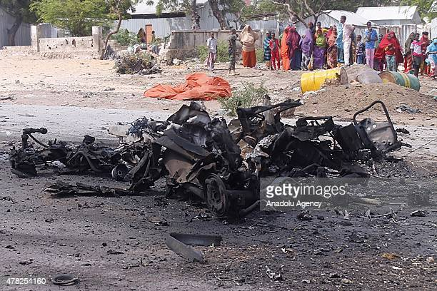 Members of the Somalian security forces inspect at the scene after a car bombing attack on United Arab Emirates embassy convoy killed seven and...