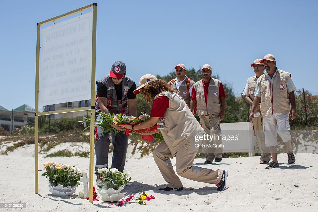 Members of the Sousse Red Crescent lay flowers for the victims of the 2015 Sousse Beach terrorist attack at a memorial on the beach in front of the Imperial Marhaba hotel on June 26, 2016 in Sousse, Tunisia. Today marks the one year anniversary of the Sousse Beach terrorist attack, which killed 38 people including 30 Britons. Before the 2011 revolution, tourism in Tunisia accounted for approximately 7% of the country's GDP. The two 2015 terrorist attacks at the Bardo Museum and Sousse Beach saw tourism numbers plummet even further forcing hotels to close and many tourism and hospitality workers to lose their jobs.