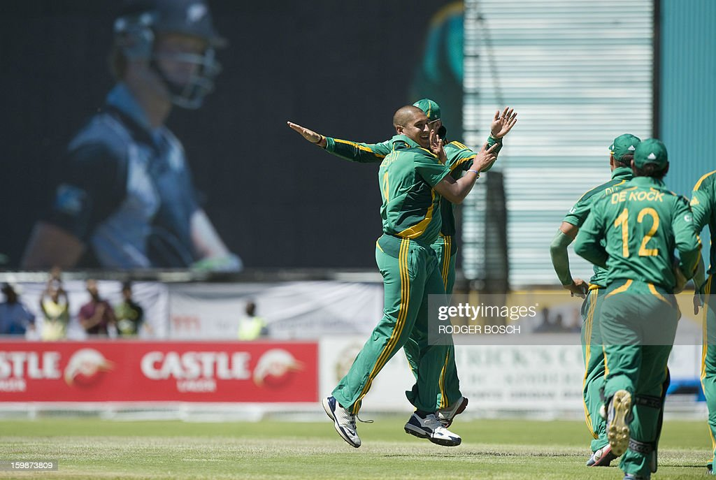 Members of the South African team celebrate on January 22, 2013 the dismissal of the first New Zealand batsman during the second one-day international (ODI) cricket match at The Diamond Oval in Kimberley. BOSCH