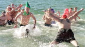 Members of the South Boston 'L' Street Bathhouse take a traditional New Year's Day dip in the fridged 30 degree waters in this Boston Massachusetts...