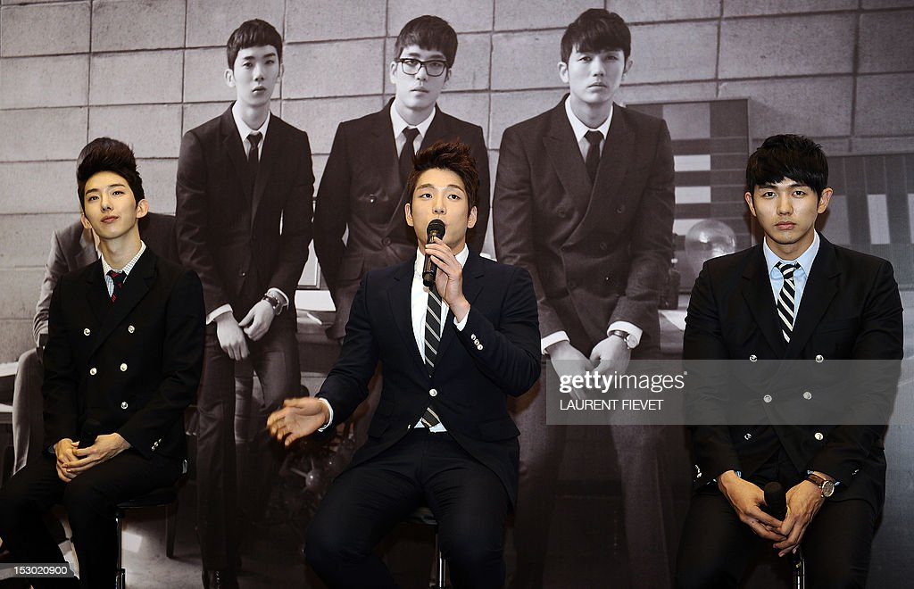 Members of the South Korean band 2AM (L-R) Jo Kwon, Lee Changmin and Lim Seulong attend a press conference in Hong Kong on September 29, 2012. The Korean 'Prince of ballad' 2AM band are on tour to promote their new album 'The Way Of Love.'