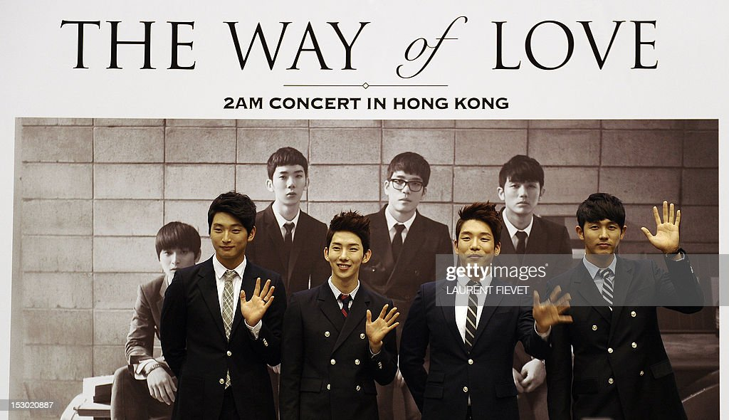 Members of the South Korean band 2AM (L-R) Jung Jinwoon, Jo Kwon, Lee Changmin and Lim Seulong attend a press conference in Hong Kong on September 29, 2012. The Korean 'Prince of ballad' 2AM band are on tour to promote their new album 'The Way of Love.'