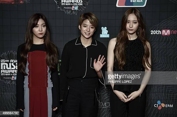 Members of the South Korean KPop music band f pose on the red carpet of the 2015 Mnet Asian Music Awards in Hong Kong on December 2 2015 AFP PHOTO /...