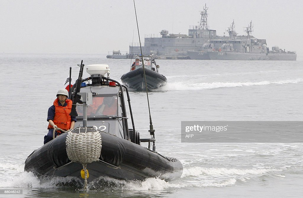 Members of the South Korean Navy take part in a drill off Yeonpyeong Island in the disputed waters of the Yellow Sea the scene of previous...
