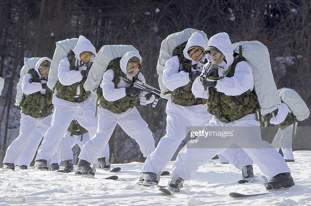 Members of the South Korean Special Warfare forces take part in a cold weather military drill in Pyeongchang on January 11, 2012. Most able-bodied men in South Korea must serve in the military for about two years, the country remaining technically at war with North Korea since their 1950-53 conflict ended only with an armistice and not a peace treaty.