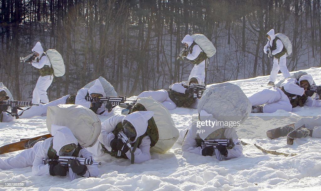 Members of the South Korean Special Warfare forces take part in a cold weather military drill in Pyeongchang on January 11, 2012. Most able-bodied men in South Korea must serve in the military for about two years, the country remaining technically at war with North Korea since their 1950-53 conflict ended only with an armistice and not a peace treaty. AFP PHOTO / WON DAI-YEON