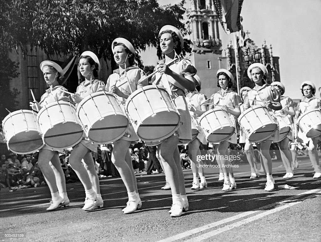 Members of the Southern Utah Girls' Drum and Bugle Corps as they march in the annual American Legion parade Los Angeles California September 20 1938
