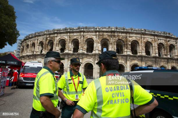 Members of the Spanish Civil Guard stand at the Arena in Nimes prior to the start of the first stage of the 72nd edition of 'La Vuelta' Tour of Spain...