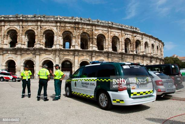 Members of the Spanish Civil Guard stand guard at the Arena in Nimes prior to the start of the first stage of the 72nd edition of 'La Vuelta' Tour of...