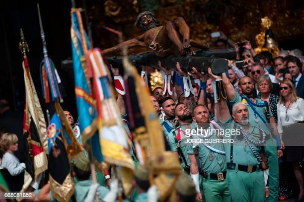 Members of the Spanish Legion carry a statue representing 'El Cristo de la Buena Muerte' to Santo Domingo de Guzman Church during a Holy Week...