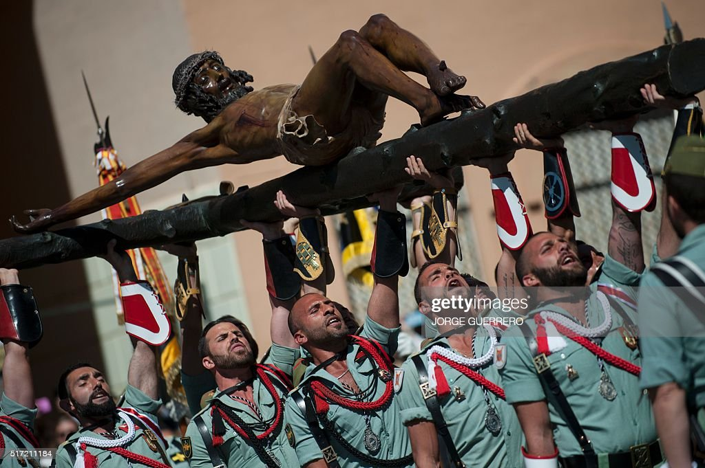 TOPSHOT Members of the Spanish Legion carry an effigy representing Christ of the Good Death before a Holy Week procession on March 24 2016 in Malaga...