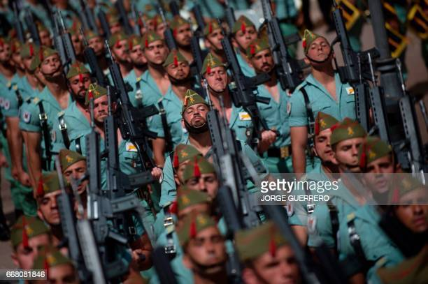 Members of the Spanish Legion march during the 'El Cristo de la Buena Muerte' Holy Week procession on April 13 2017 in Malaga southern Spain...