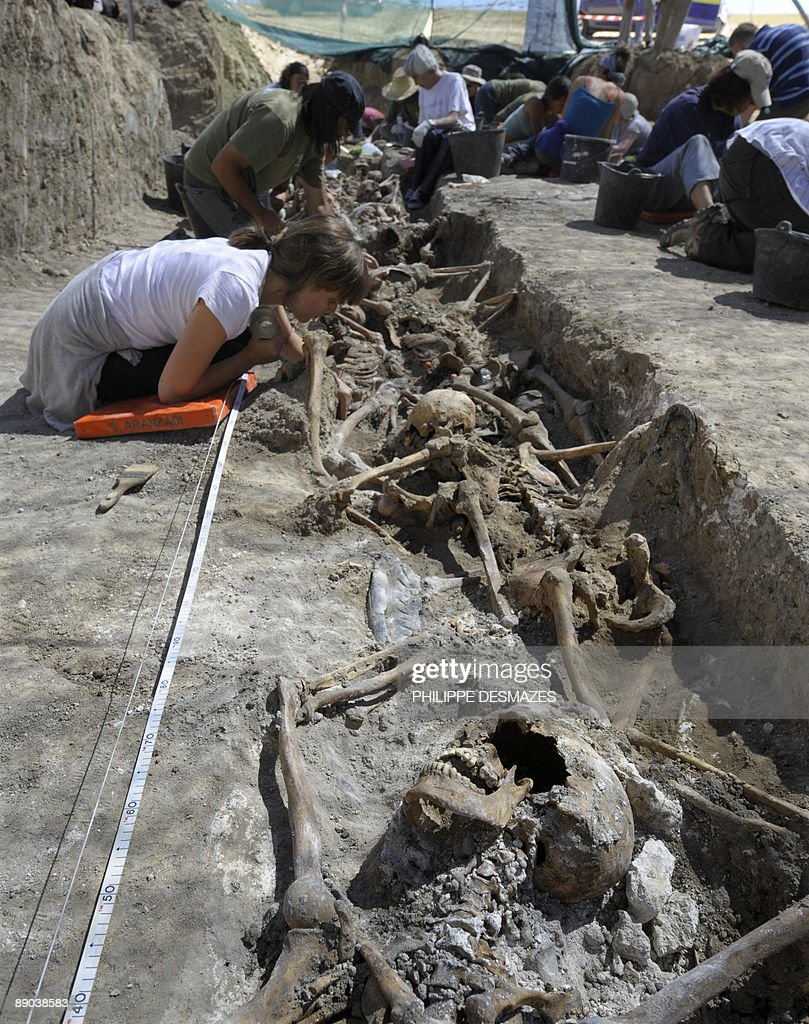 Members of the Spanish organisation Association for the Recuperation of Historic Memory exhume remains of victims executed by Franco's security...