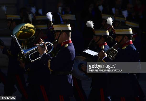 Members of the Spanish Royal Guard parade during a welcoming ceremony for the Israeli president at the Royal Palace in Madrid on November 6 2017 /...