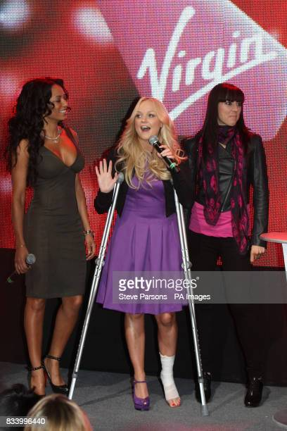 Members of the Spice Girls Mel B Emma Bunton Mel C arrive back in Britain to open Virgin Atlantic's New Terminal at Heathrow Airport