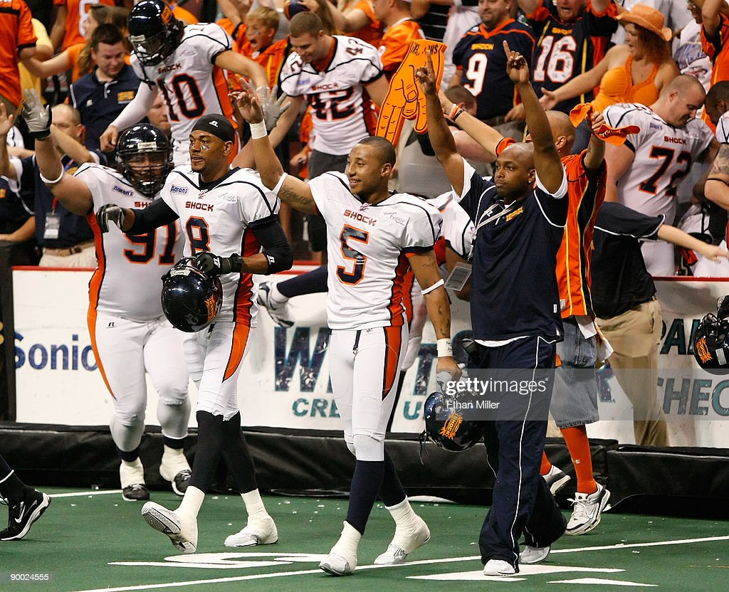 Members of the Spokane Shock including Markee White #8 and Charles Dillon #5 walk on the field to celebrate as time expires in the team's 74-27 victory over the Wilkes-Barre/Scranton Pioneers in the AFL2 ArenaCup 10 at the Orleans Arena August 22, 2009 in Las Vegas, Nevada.