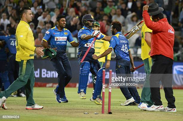 Members of the Sri Lankan team celebrate after winning the T20 cricket match between Sri Lanka and South Africa at Newlands Stadium on January 25 in...